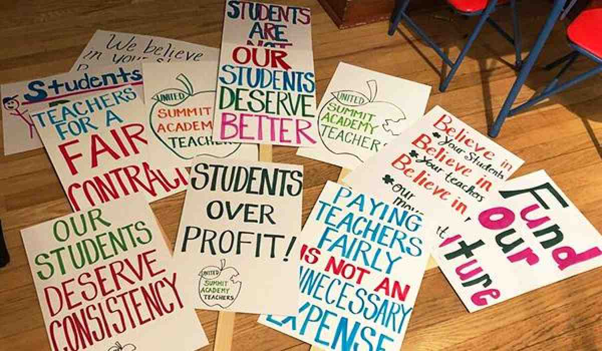 summit academy strike signs