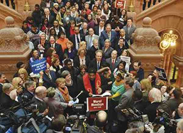 Rev. William Barber and AFT President Randi Weingarten lead a protest at the New York capitol.