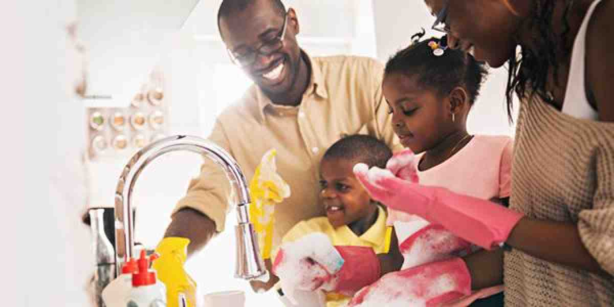 a black family happily washes dishes together