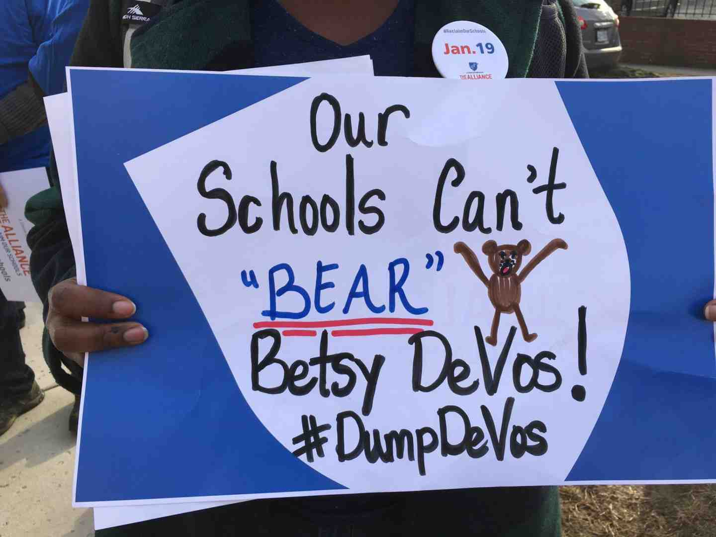 Anti-DeVos sign