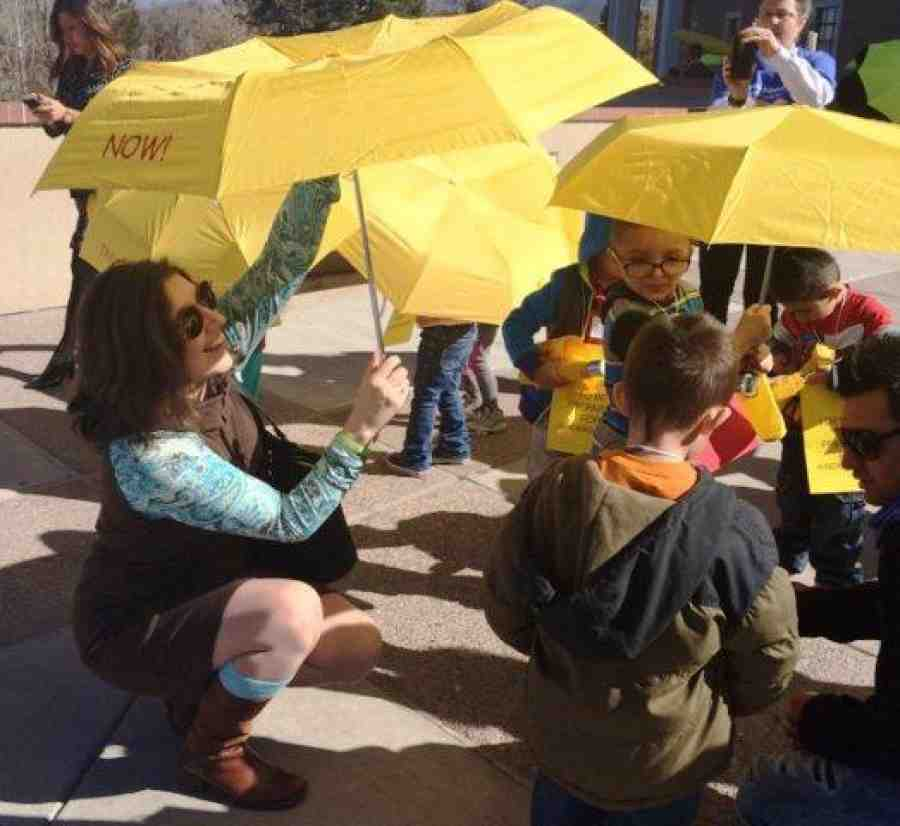 Mary Cathryn Ricker with kids at New Mexico march