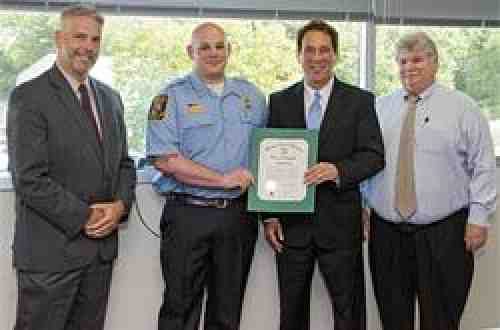 Morris receiving a citation from Baltimore County for his AFT Everyday Hero nomination.