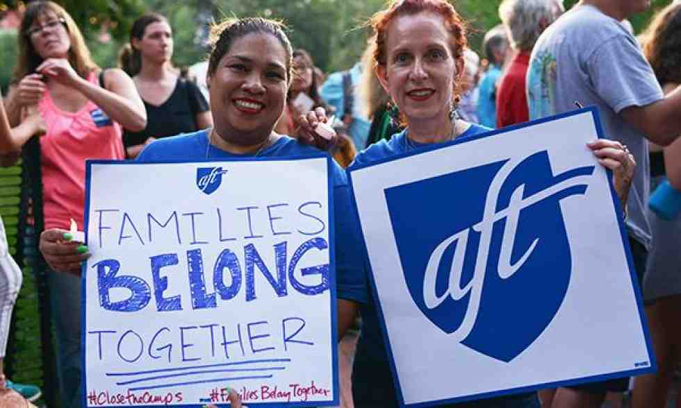 AFT members rally at vigil