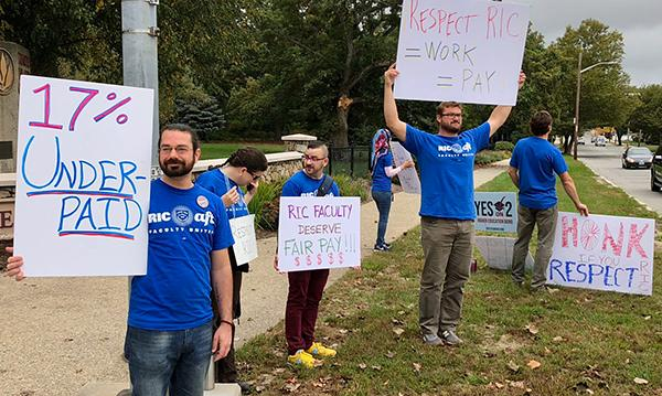 Sign holders at Rhode Island College