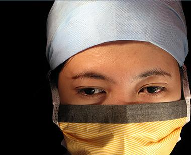 Asian person wearing mask