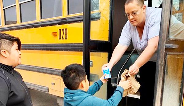 bus driver giving child food