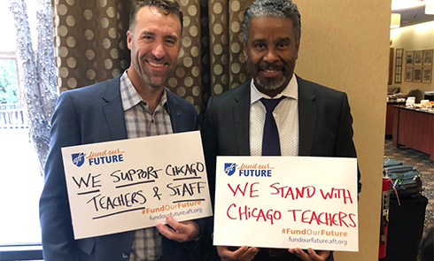 From left, Jeff Freitas, president of the California Federation of Teachers, an Philippe Abraham, secretary-treasurer of the New York State United Teachers, show solidarity for the Chicago Teachers Union. Both are also AFT vice presidents.