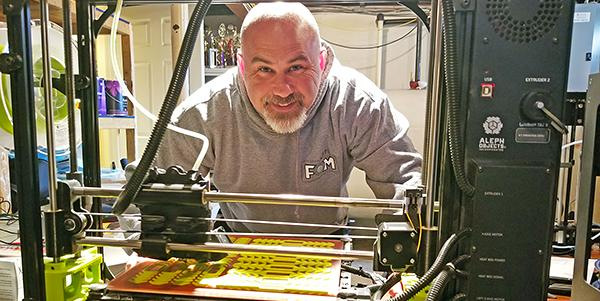 Michael Shunney pictured with 3D printer