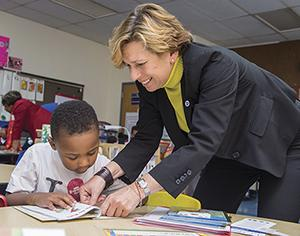 Randi Weingarten with a student at a Baltimore First Book event