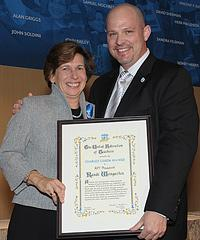 Randi Weingarten receives the Charles Cogen Award from UFT president Michael Mulgrew. Photo by Miller Photography.