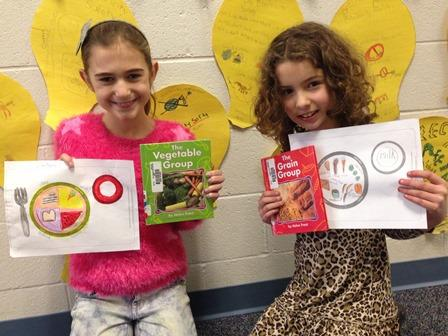 Students showing off healthy eating materials
