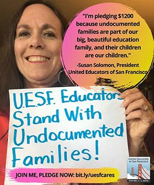 woman holds sign that supports standing with undocumented families
