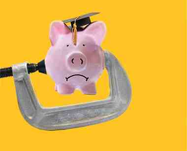 A frowning piggy bank with a graduation cap is stuck in a wrench.