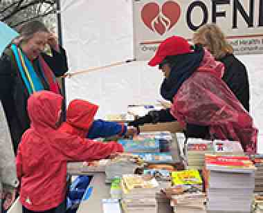 OFHNP delivers books to children