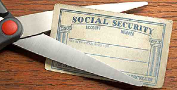 scissors cutting social security card